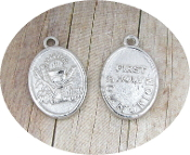 "Silver Plated Holy Blessed Sacrament Chalice 7/8"" oval medal FIRST HOLY COMMUNION wording on back side FIRST HOLY COMMUNION-Measurement does not include eyelet"